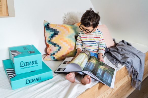 Boy reading a picture book at home